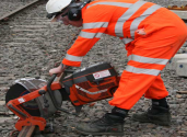 Operator cutting a rail track